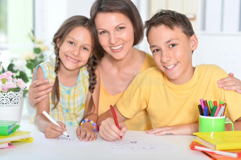 Portrait of a happy family drawing at home. Portrait of happy family drawing at home royalty free stock images