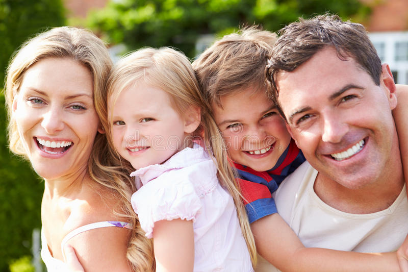 Portrait Of Happy Family In Garden royalty free stock image