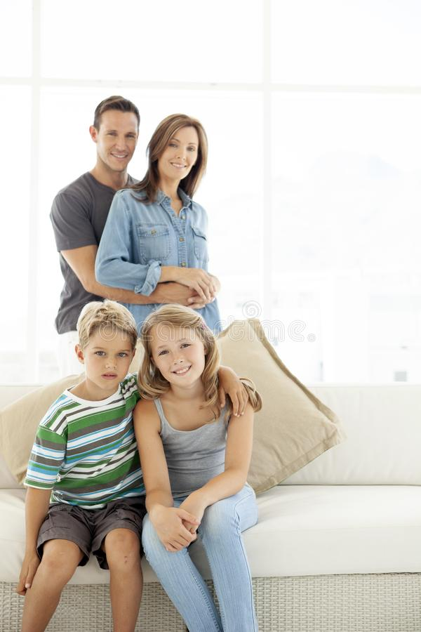 Portrait of happy family at home stock image