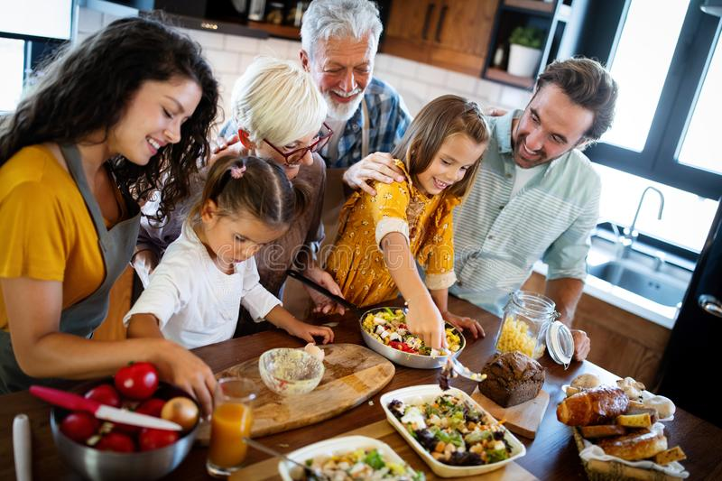 Portrait of happy family in kitchen at home stock image