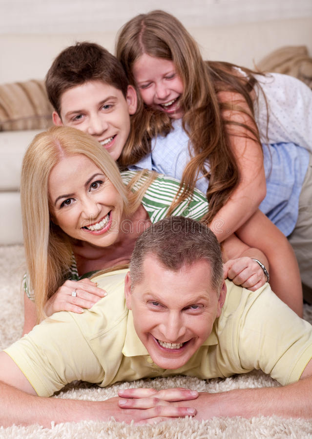 Portrait of happy family Lying On Top stock image