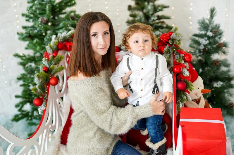 Portrait of happy family mother and her sun in decorated Christmas room royalty free stock photos