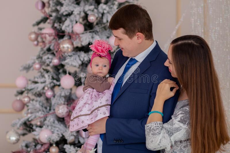 Portrait of happy family near Christmas tree.Family, christmas, winter,happiness and people concept stock images