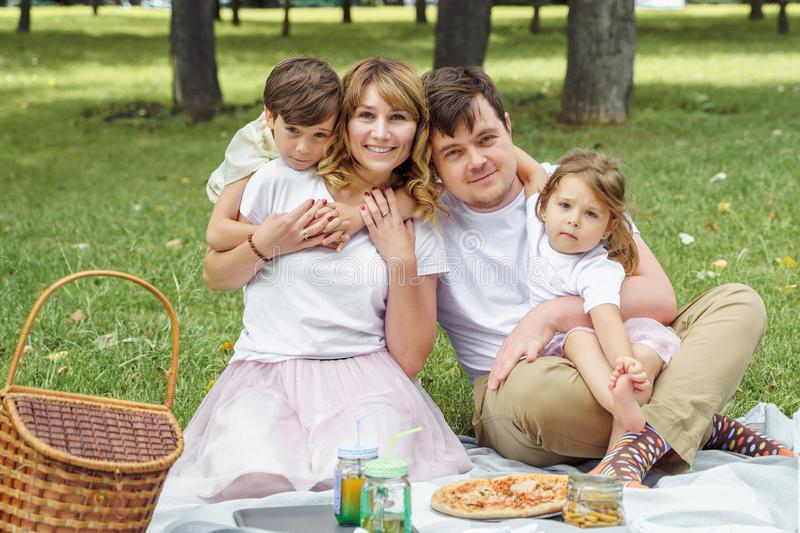 Portrait of a happy family on a picnic on a sunny summer day stock photography