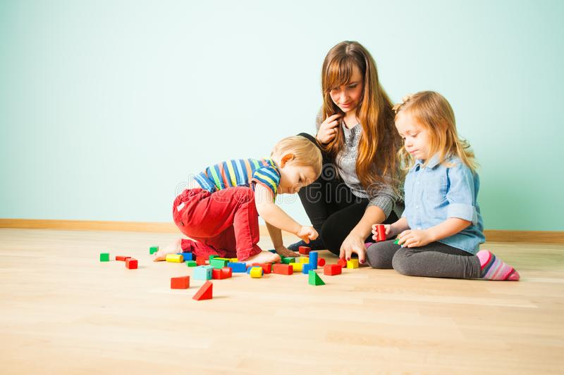 Portrait of happy family playing together indoors stock photography