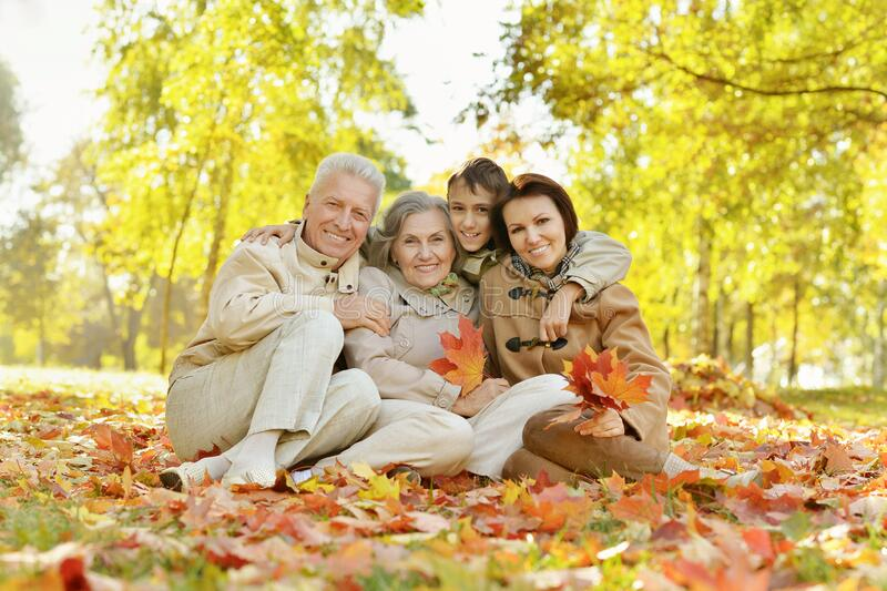 Portrait of happy family relaxing in autumn forest stock photos