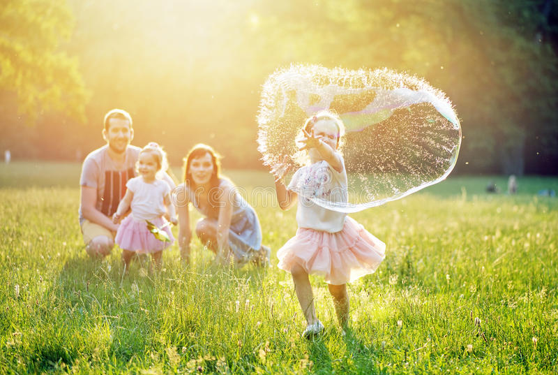 Portrait of a happy family resting in the park stock photo