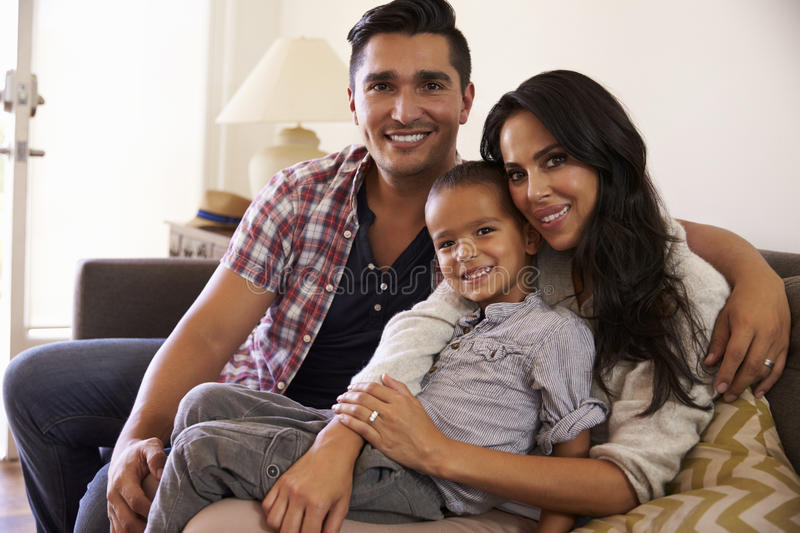 Portrait Of Happy Family Sitting On Sofa In at Home stock image