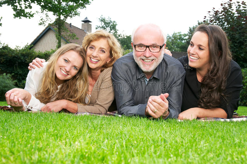 Portrait of a happy family smiling together outdoors stock photos