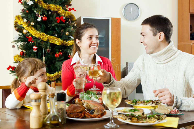 Portrait of Happy family of three celebrating Christmas royalty free stock image