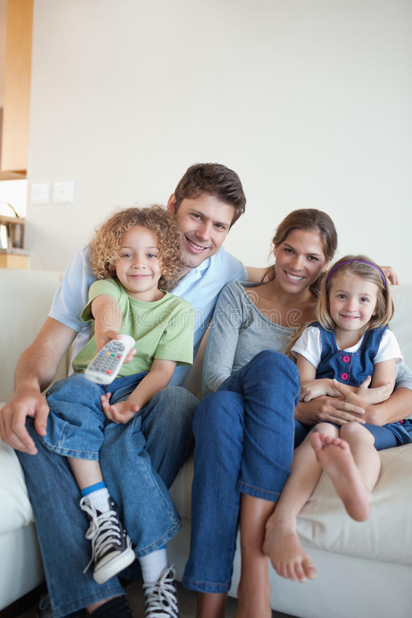 Download Portrait Of A Happy Family Watching TV Together Stock Photo - Image: 22660880