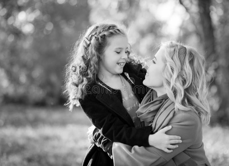Happy joyful woman having fun with her girl in autumn color royalty free stock photo