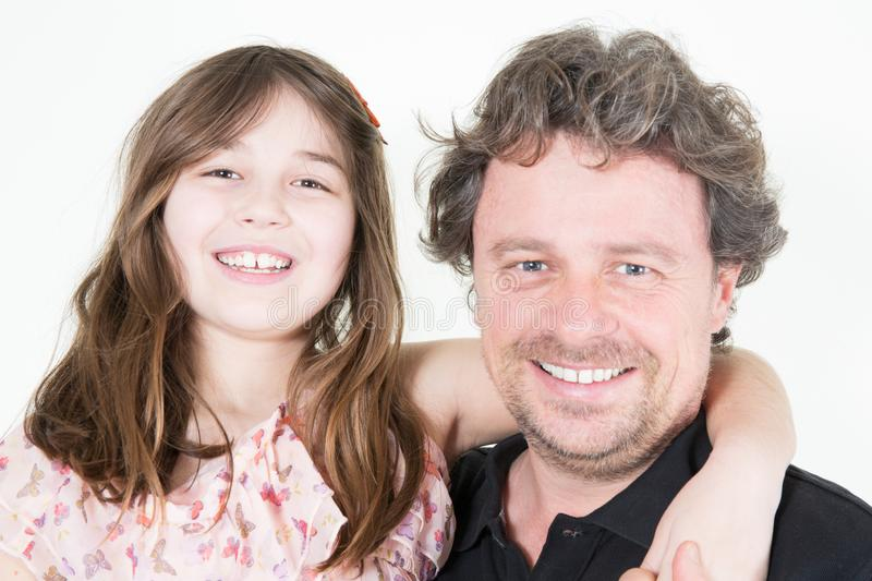 Portrait of a happy father and a beautiful little girl daughter royalty free stock photo