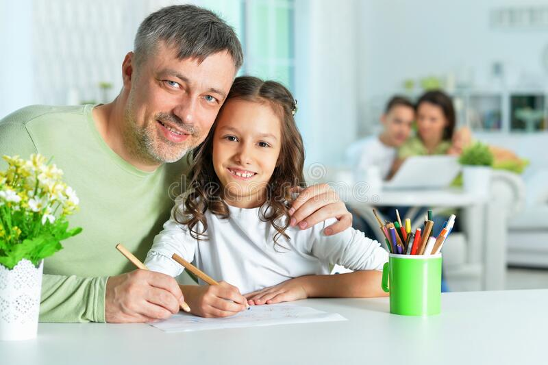 Portrait of happy father and his cute daughter drawing royalty free stock photos