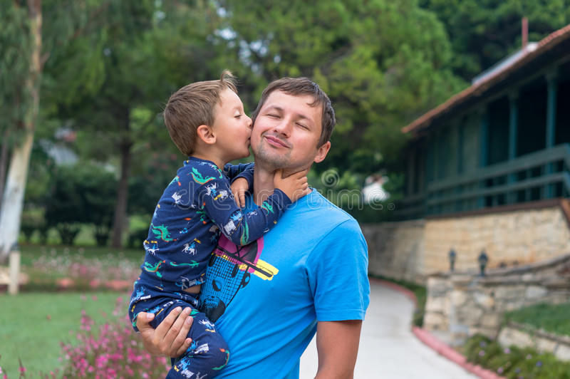 Portrait of a happy father with his little son on vacation. Little boy kisses and hugs his father. Happy fathers day.Happy family. royalty free stock photos