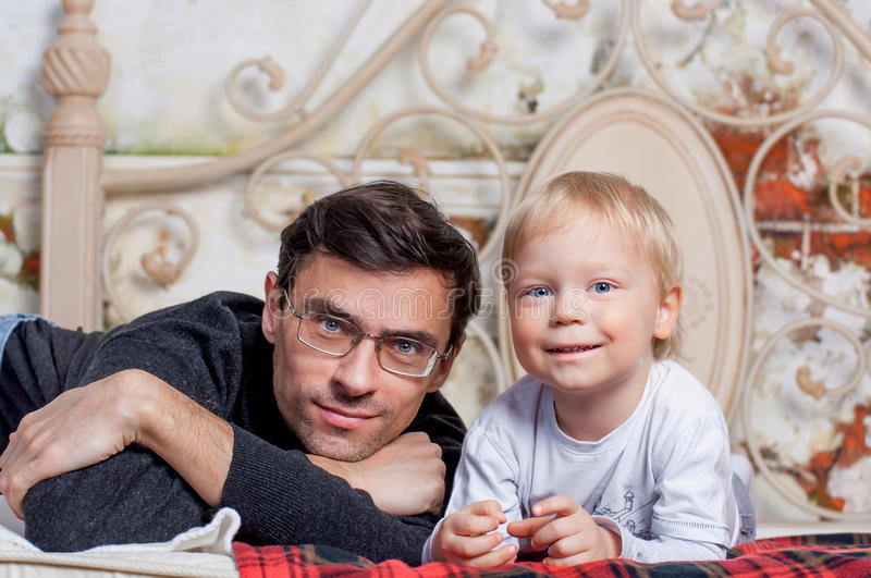 Portrait Of Happy Father with his to kid stock image