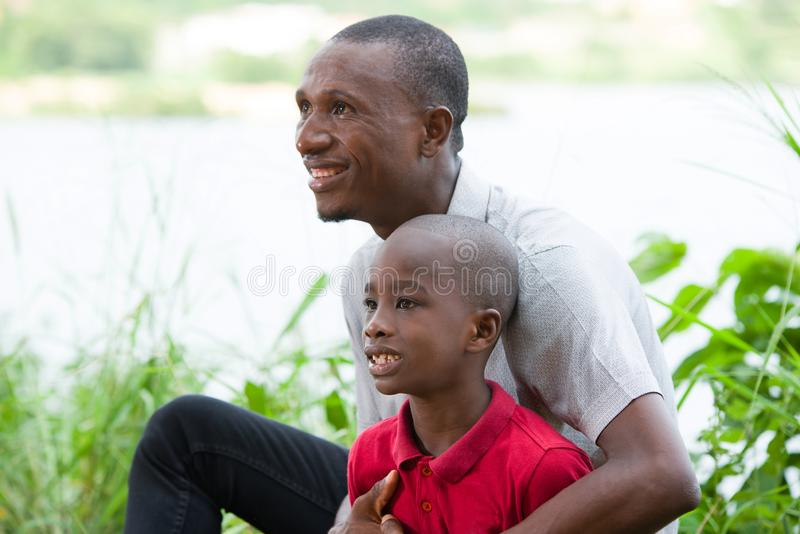 Portrait of Happy Father and Son In Park royalty free stock images