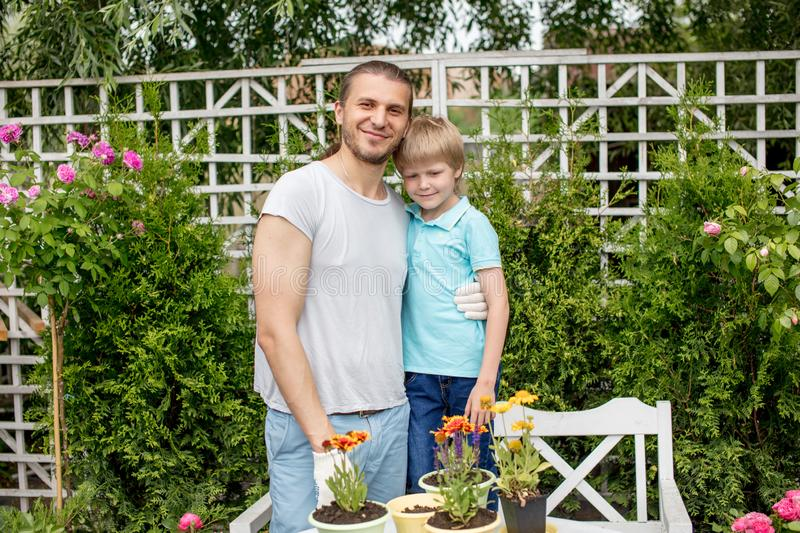 Portrait of happy father and son standing in yard royalty free stock photo