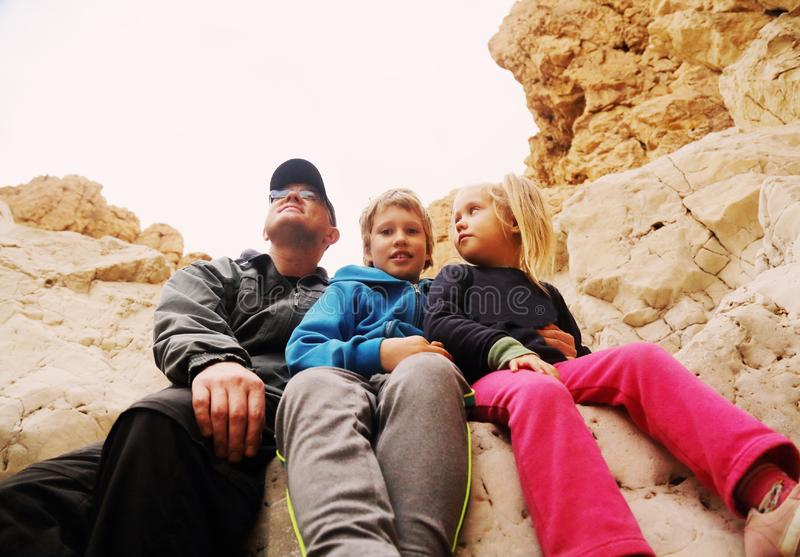 Father with two kids royalty free stock photo