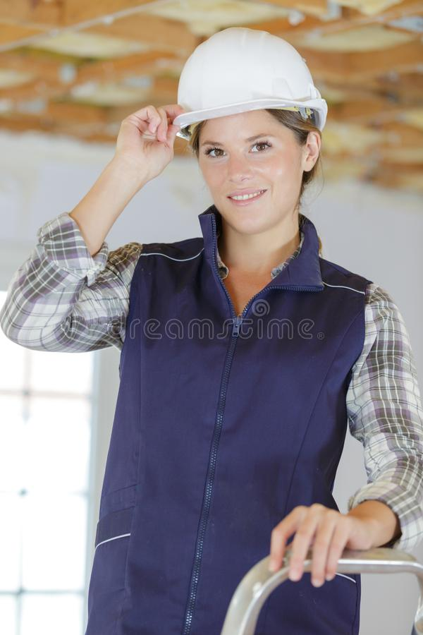 Portrait happy female builder royalty free stock image