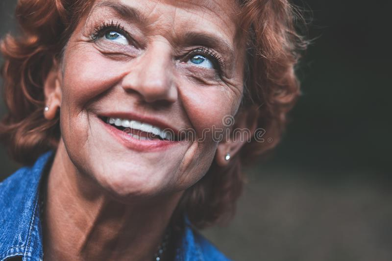 Portrait of a happy fifty year old woman stock photography
