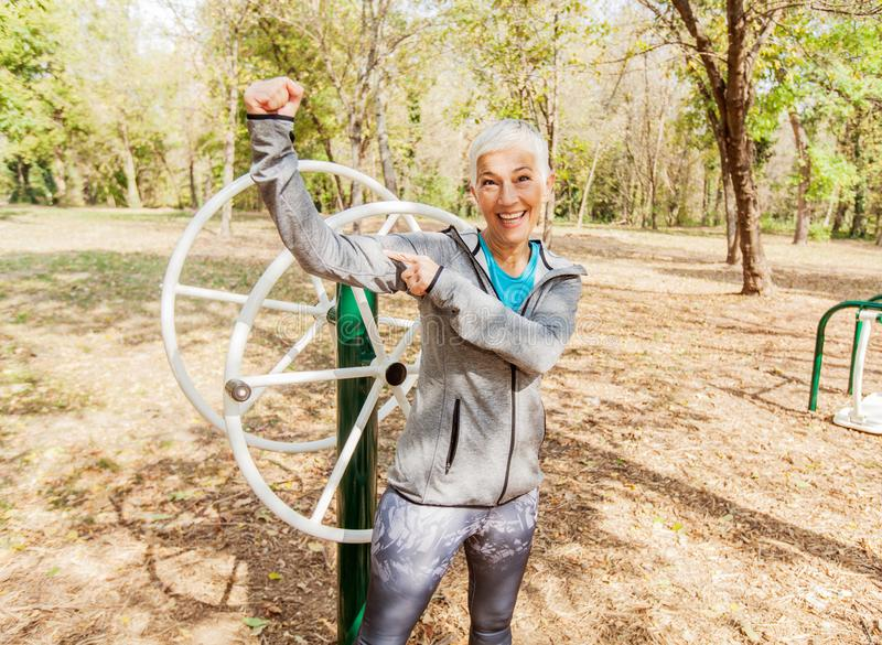 Portrait Of Happy Fit Senior Woman Exercise At Outdoor Gym royalty free stock photo
