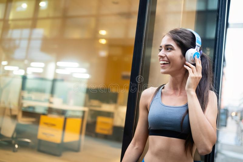 Portrait of happy fit woman in city. Healthy lifestyle concept. Portrait of attractive fit woman in city. Healthy lifestyle concept stock image