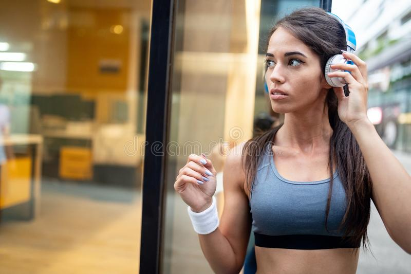 Portrait of happy fit woman in city. Healthy lifestyle concept royalty free stock photography
