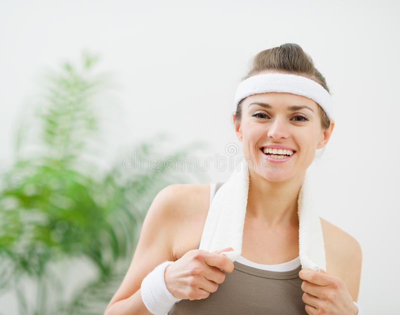 Portrait of happy fitness woman with towel royalty free stock photo