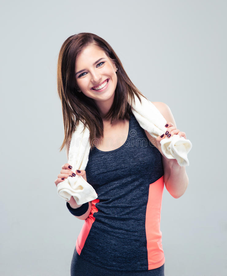 Portrait of a happy fitness woman with towel stock photography