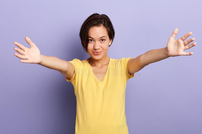 Portrait of a happy friendly kind young girl with outstretched hands to embrace royalty free stock image