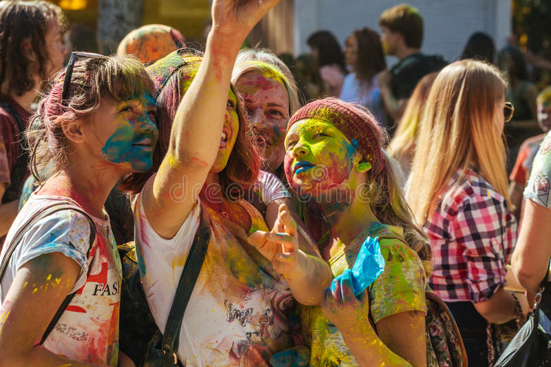 Portrait of happy friends on holi color festival making selfi stock images