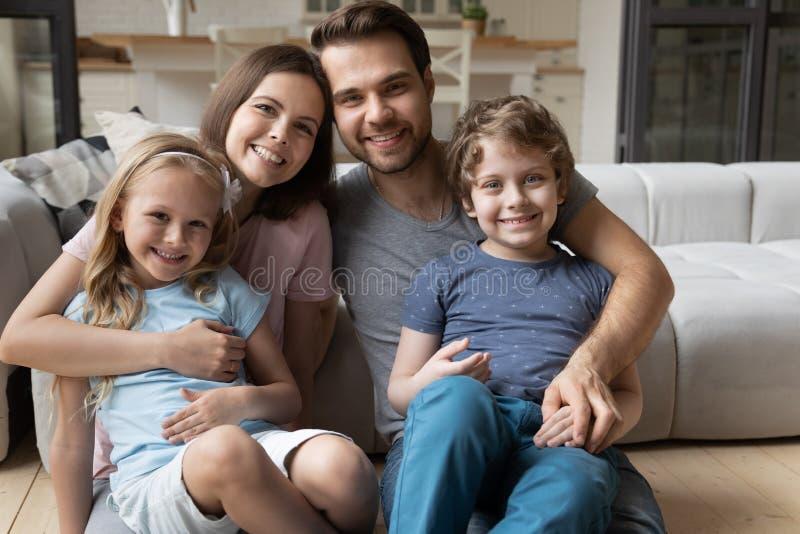 Portrait of happy full bonding family of four. stock images