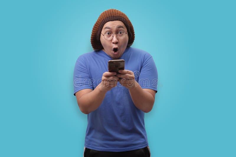 Shocked Happy Man Looking at Smart Phone royalty free stock photos