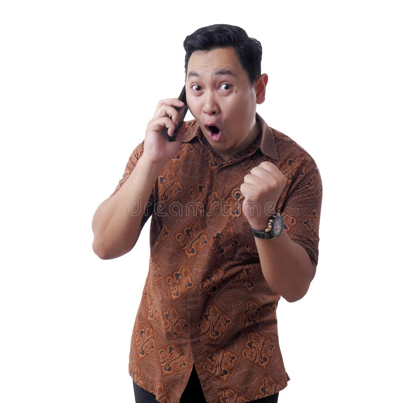 Shocked Happy Man Looking at Smart Phone stock photos