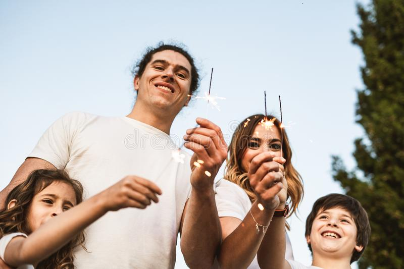 Portrait of a happy and funny young family outdoors. Family lifestyle concept royalty free stock photography