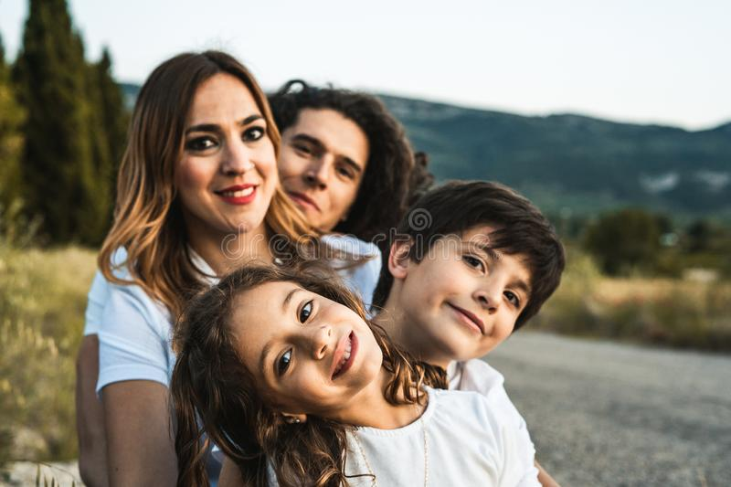Portrait of a happy and funny young family outdoors. Family lifestyle concept royalty free stock photo