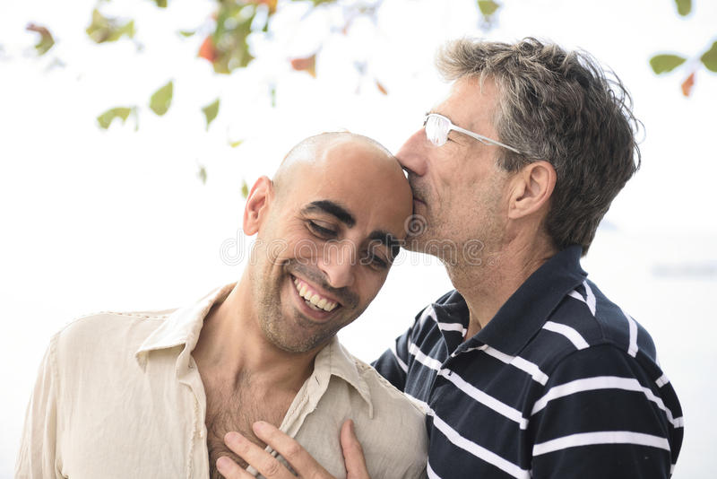 Portrait of a happy gay couple royalty free stock photo