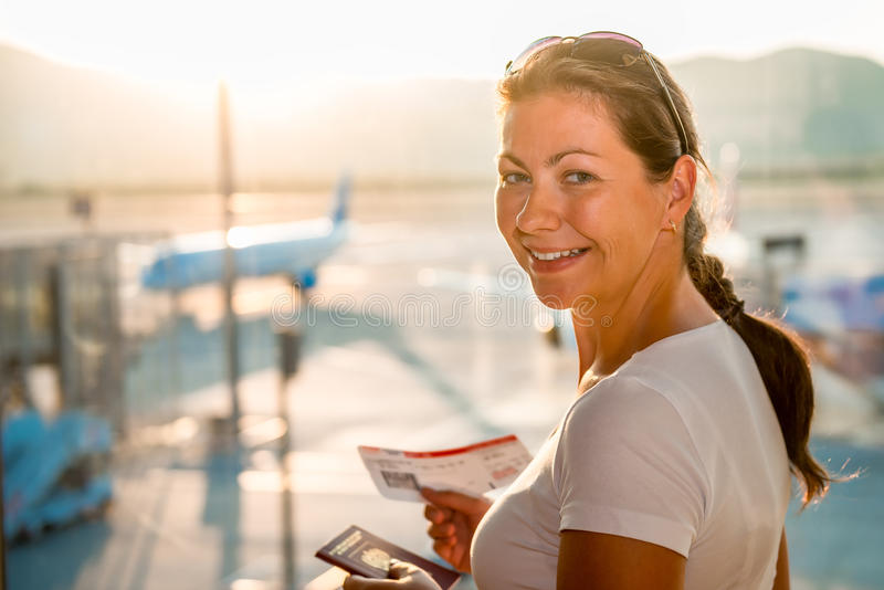 Portrait of happy girl. At the airport stock images