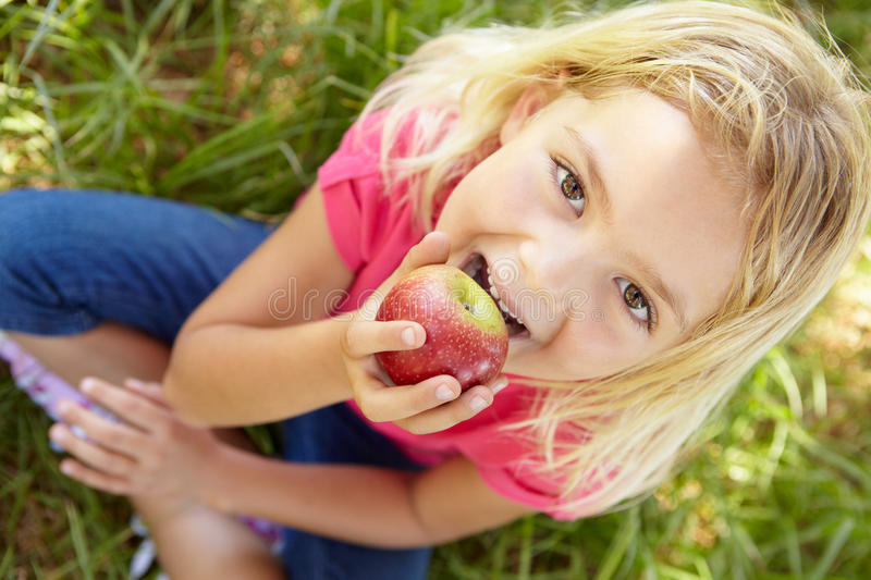 Portrait of happy girl with apple royalty free stock photography