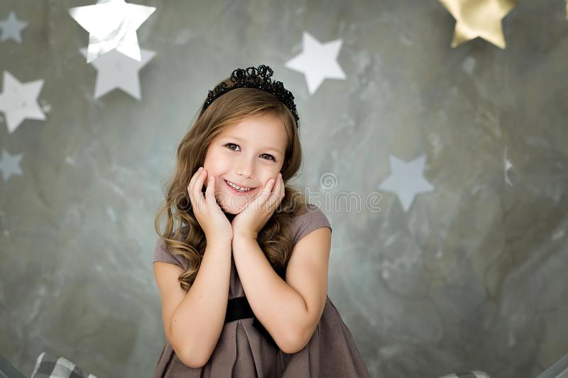Portrait of a happy girl on a background of stars royalty free stock photo