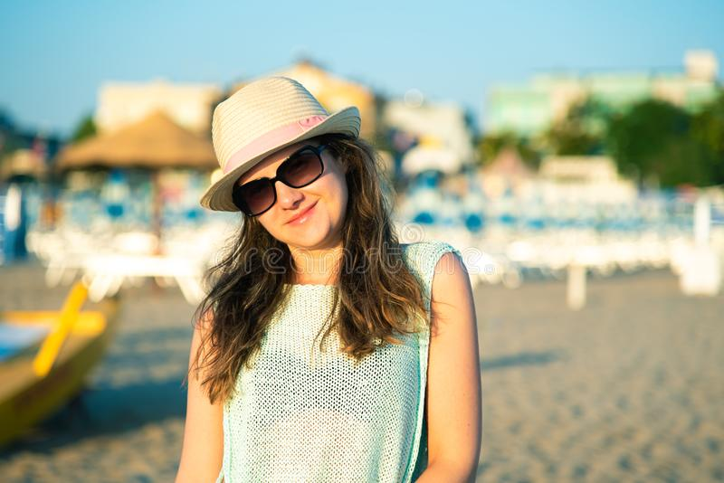 Portrait of a happy girl on the beach in the morning at sunrise.  royalty free stock image