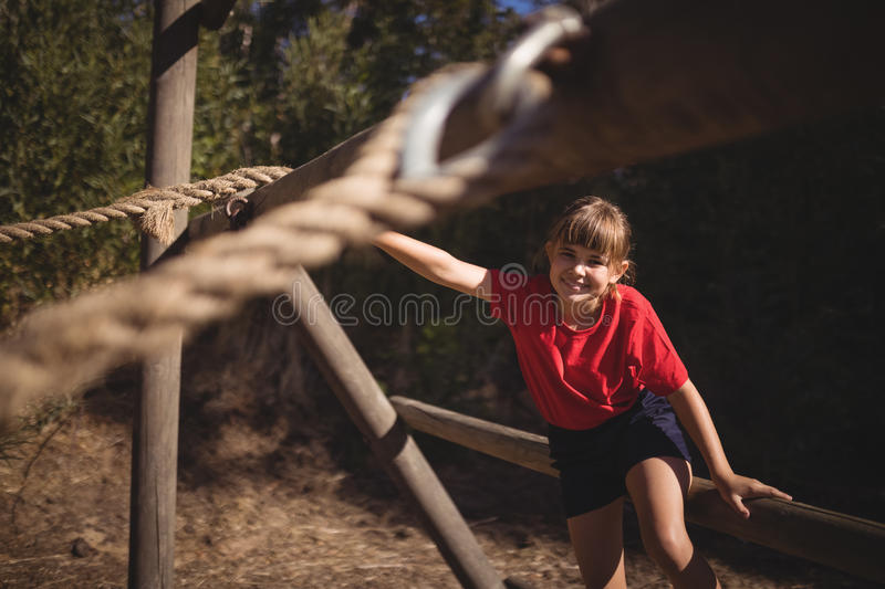 Portrait of happy girl exercising on outdoor equipment during obstacle course stock photos