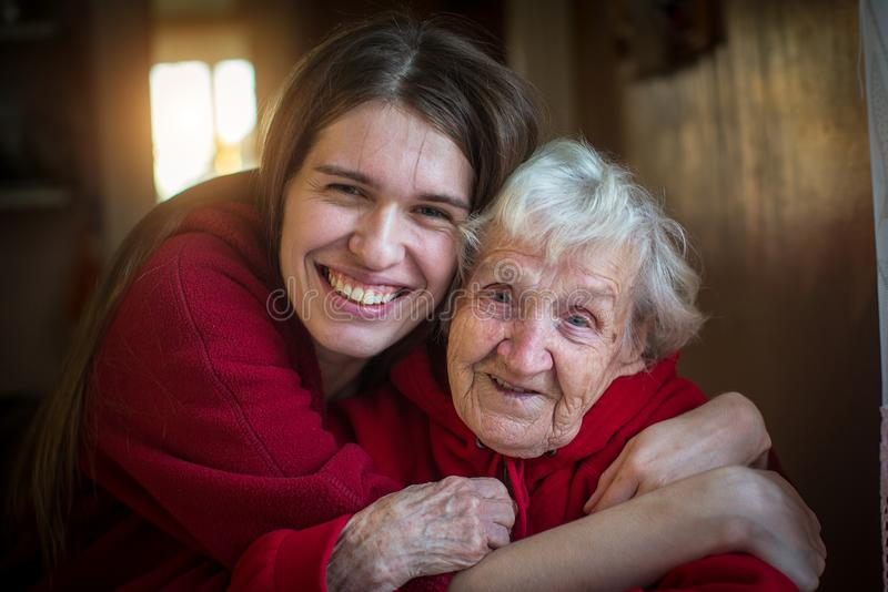 Portrait of happy Girl hugging her grandmother. stock photography