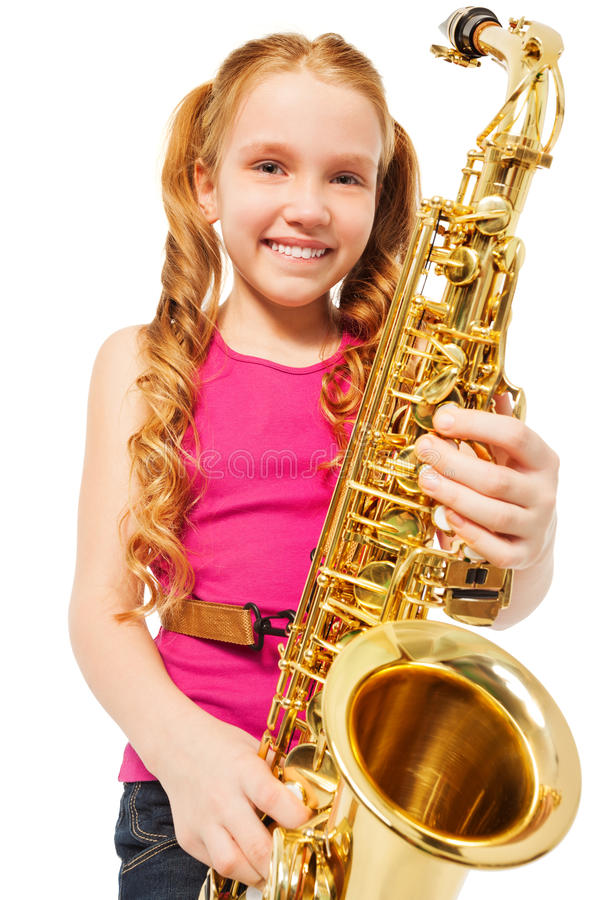 Portrait of happy girl playing alto saxophone. On the white background royalty free stock images