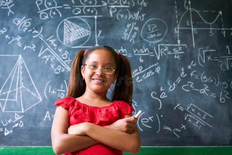 Portrait Happy Girl Resolving Complex Math Problem On Blackboard stock images