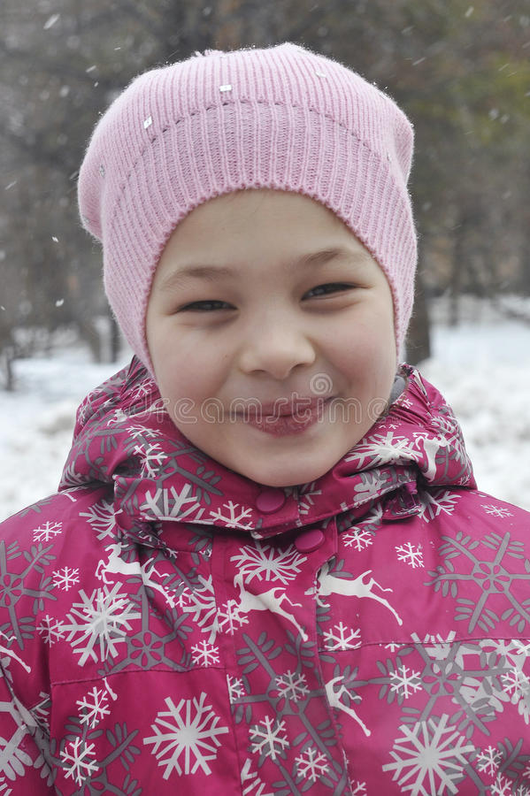 Portrait of the happy girl in winter clothes. stock photos