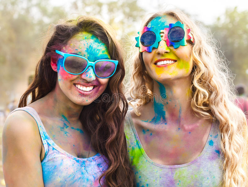 Portrait of happy girls on holi color festival stock images