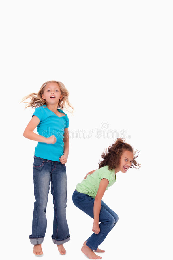 Portrait Of Happy Girls Jumping Stock Images