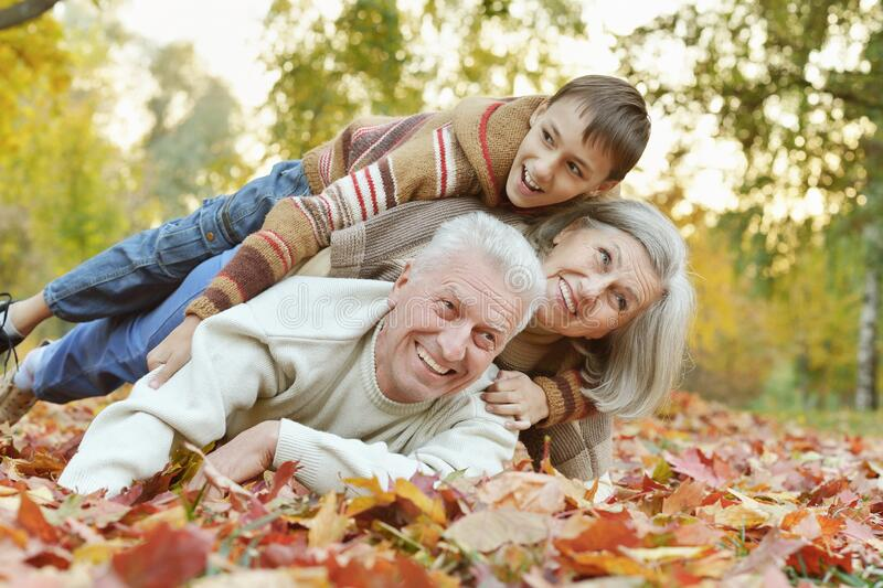 Portrait of happy grandfather, grandmother and grandson stock images